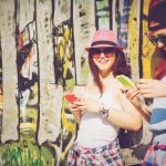 20150406154047-millennials-teenagers-girls-smartphones-texting-women-graffiti-wall-friends-hipsters-happy-young